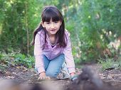 stock photo of pharyngitis  - Young girl walking at the green forrest - JPG