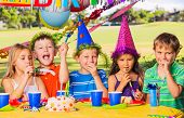 Group of adorable kids at birthday party