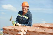 Portrait of construction mason worker bricklayer with trowel putty knife outdoors at building area