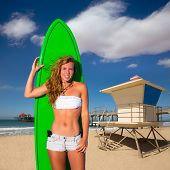 Blond surfer teen girl holding surfboard in Huntington Beach pier California [photo-illustration]
