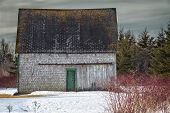 An old barn in the winter landscape.
