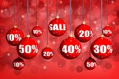 Red Christmas balls with numbers and percent symbols for Christmas sale