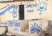Orchha, India - February 2011: Political Symbols Of Three Different Parties On The Same House Wall.