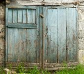 Old barn door painted blue