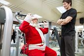 Santa Claus  exercise with personal trainer in the gym