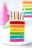 stock photo of occasion  - Rainbow cake decorated with birthday candles - JPG