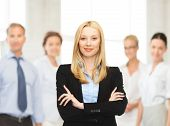 office, buisness, teamwork concept - friendly young smiling businesswoman