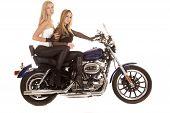 Two Women Sit Motorcycle Side
