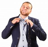 picture of take off clothes  - tired businessman taking off necktie - JPG