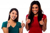 Two Girls Cheering Up With Thumbs Up
