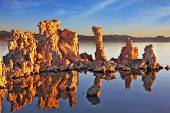 Outliers -  bizarre calcareous tufa formation  reflected in the mirrored surface of the water. A pi