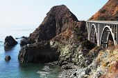 The magnificent bridge on coastal highway of rocky and steep Pacific coast USA