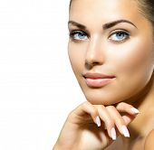 Beauty Portrait. Beautiful Spa Woman Touching her Face. Perfect Fresh Skin closeup. Isolated on Whit