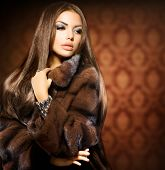 Beauty Fashion Model Girl in Mink Fur Coat. Beautiful Woman in Luxury Brown Fur Jacket . Winter Fash