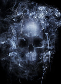 stock photo of cranium  - Photo montage of a human skull surrounded by cigarette smoke - JPG