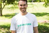 Portrait of confident male volunteer standing in park