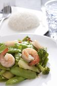 stock photo of snow peas  - Stir fried snow peas and shrimp served with rice - JPG