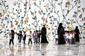 ABU DHABI, UAE - MARCH 4, 2010: Group of children visiting Sheikh Zayed Mosque