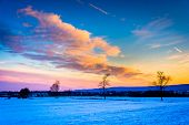 Winter Sunset Over A Farm Field In Rural Frederick County, Maryland.