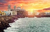 Picturesque View Of Cadiz Quay And Cathedral Campo Del Sur At Sunrise
