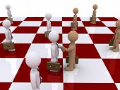 Two Businessmen On Chessboard Shake Hands