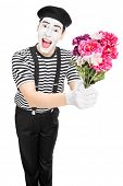 Male mime artist holding a bouquet of flowers isolated on white background