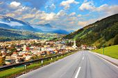 Gorgeous Austria. The road in the Alps. The picturesque small town is wonderfully illuminated by the sun
