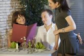 image of indecent  - man holding his hand on waitress buttocks in a restaurant - JPG