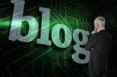 The word blog and thoughtful businessman standing back to camera against green and black circuit boa