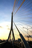 The Rama Viii Bridge Over The Chao Praya River At Sunset In Bangkok, Thailand