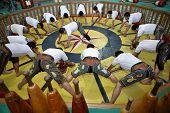 YAZD, IRAN - NOVEMBER 29, 2007: Pahlevani and zoorkhaneh rituals.Traditional Iranian system of athletics originally used to train warriors