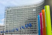 BRUSSELLS - FEB 24, 2014: Photo of European Union flags in front of the Berlaymont building (Europea