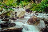 stock photo of himachal  - Vintage retro hipster style travel image of cascade of Bhagsu waterfall in Himalayas - JPG