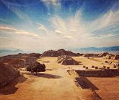 Vintage retro hipster style travel image of ancient civilization ruins on plateau Monte Alban in Mex