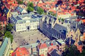 Vintage retro hipster style travel image of aerial view of the Burg square with the City Hall. Bruge