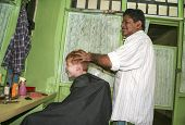 Caucasian Boy With Red Hair At A Local Hairdresser