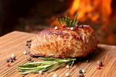 Grilled Beef Steak On A Background Of Fire