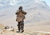 Mt Kailash, Tibet, China - May 26, 2012: Buddhist pilgrim making the kora (circumambulation) around
