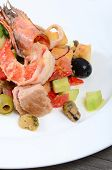 Salad with seafood with a squid, a tuna fillet, meat of mussels