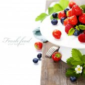 Assorted berries on a plate (with easy removable sample text)