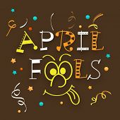 Happy Fool's Day funky concept with colorful text on brown background.
