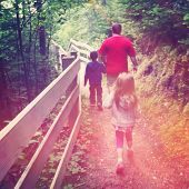 Father waling with children outdoors - instagram effect