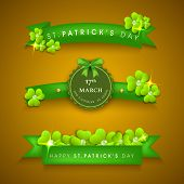 Happy St. Patrick's Day celebrations concept with ribbon, tag or label decorated by shamrock leaves