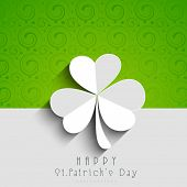 Happy St. Patrick's Day celebrations concept with beautiful Irish lucky shamrock leaf on green and grey background.