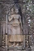 SIEM REAP, CAMBODIA - CIRCA November 2013: Bas-Relief of Apsara Carved in Bayon Temple