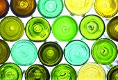 variety of empty wine bottles backlited