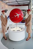 Emirates Airlines flight attendants at the Emirates Airlines booth at the US Open 2014
