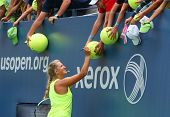 Two times Grand Slam champion Victoria Azarenka signing autographs after practice for US Open 2014