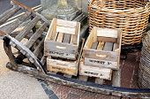 Wooden crates on old wooden cart.