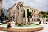 Unidentified Tourists Near Fountain In Place D' Assas, Nimes, France